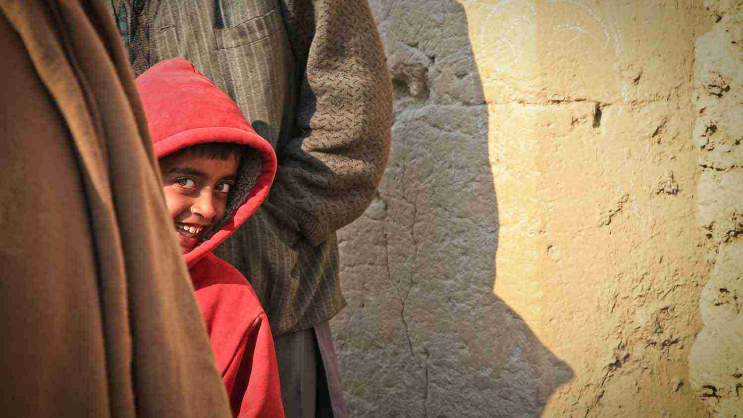 Small boy smiles at the camera in Afghanistan